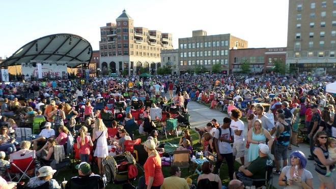 Hundreds of people fill The 400 Block for an outdoor concert in 2015.