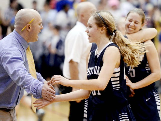 West York's Kari Lankford receives congratulations from her coach after beating York Catholic in the YAIAA semifinal at Central York High School on Tuesday, February 12, 2013. West York won, 59-54. (DAILY RECORD/SUNDAY NEWS - KATE PENN)