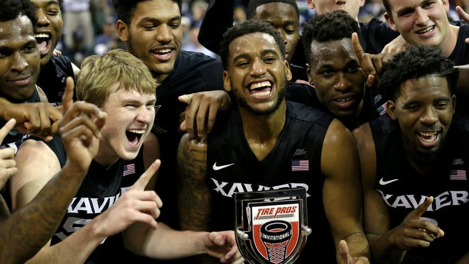 Xavier players celebrate after winning the Tire Pros Invitational tournament in 2016