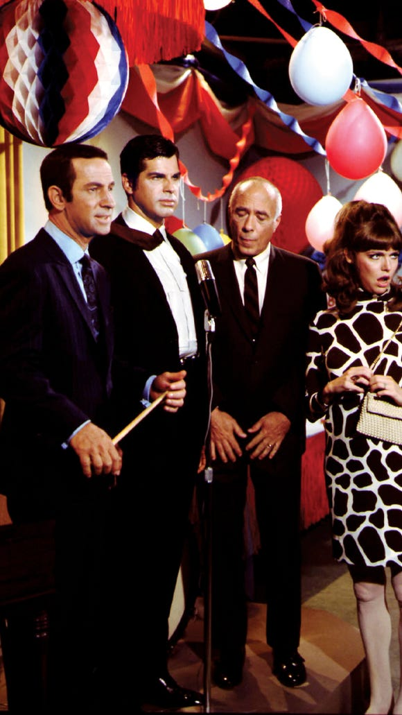 "Don Adams, left, Dick Gautier, Edward Platt and Barbara Feldon starred in ""Get Smart."""