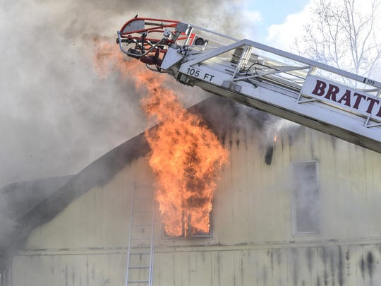 Several departments respond to a fire that destroyed the Newfane Cafe and Creamery in Newfane on Wednesday.