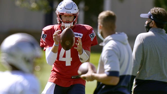 New England Patriots quarterback Jarrett Stidham catches the ball during an NFL football practice on Aug. 31 in Foxborough, Mass.