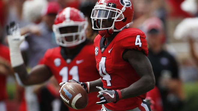 Georgia wide receiver Mecole Hardman breaks loose on a kickoff return for a touchdown during the first half of a game against Tennessee in 2018.