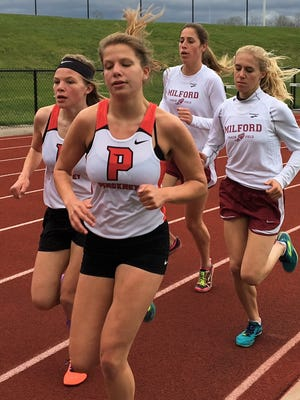 Pinckney's Isabella Garcia leads the pack in the early going in the 1,600-meter run against Milford on May 2, 2017. Behind her are (left to right) teammate Noelle Adriaens, and Milford's Mallory Barrett and Victoria Heilingenthal.