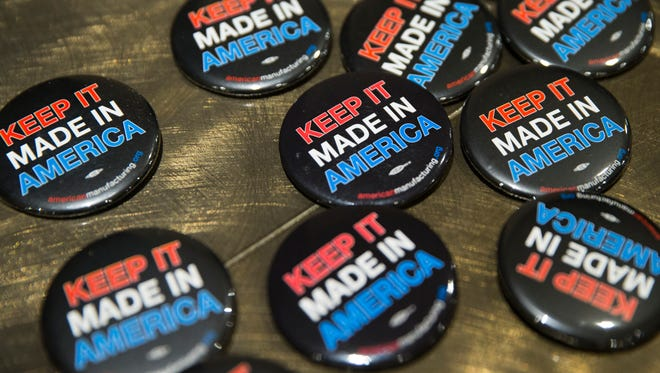 Buttons at a rally at the downtown Sheraton Hotel in support of industrial manufacturer Rexnord, which is slated to lose 300 jobs to Mexico, Thursday, Feb. 2, 2017.