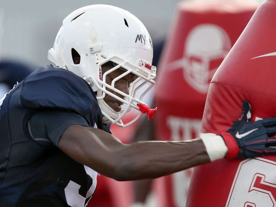Arizona Wildcats freshman My-King Johnson works out at a 2017 fall practice.