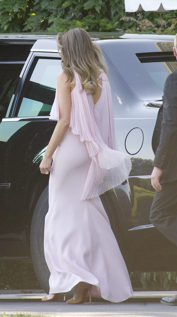 The back of the gown has criss-cross detailing.