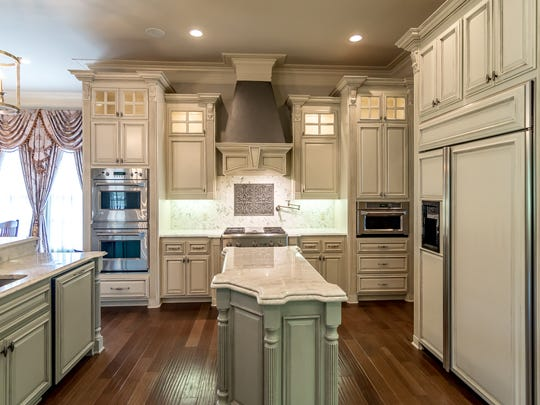 A cook's kitchen for sure, this space offers all the amenities that one could wish for with the pot filler, double ovens and built-in refrigerator/dishwasher/ice maker.