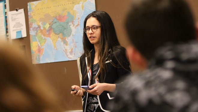 18 year-old Brittany Stinson, a senior at Concord High School, gives an oral presentation about Islam during her honors English class. Stinson recently blew up social media with her college entrance application essay about Costco and has been accepted to eleven colleges so far.