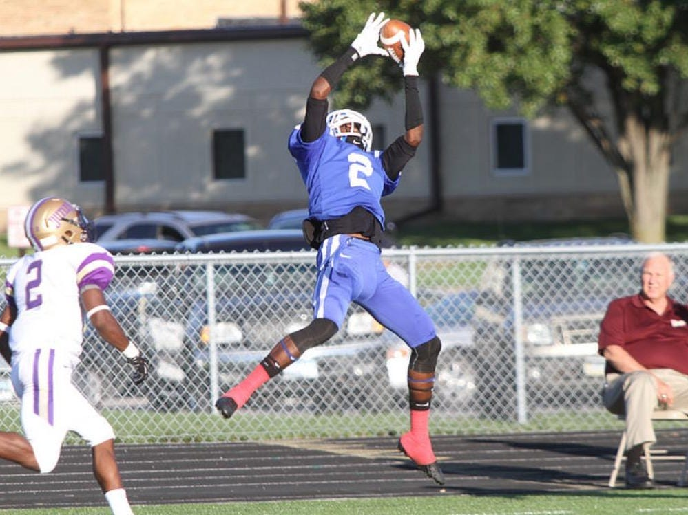 Former Lincoln receiver Taj Williams skies for a catch as a member of Iowa Western Community College during a game last year. Williams just committed to TCU as the No. 1 JUCO receiving prospect in the country.