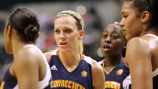 FILE -- Katie Douglas made her return to Indy with a new team, the Connecticut Sun, May 29, 2014 at Bankers Life Fieldhouse.