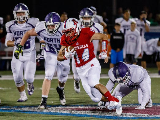 Arrowhead running back Carson Myers (14) rumbles out