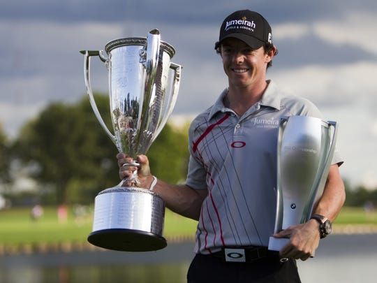 Rory McIlroy holds the hardware he earned after the 2012 BMW Championship at Crooked Stick Golf Club in Carmel.