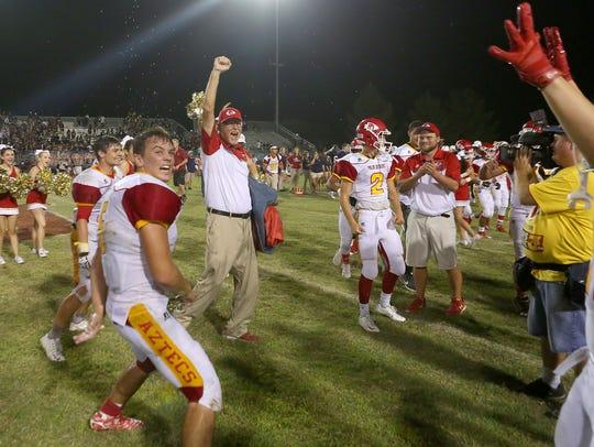 Palm Desert coach Pat Blackburn celebrates the return