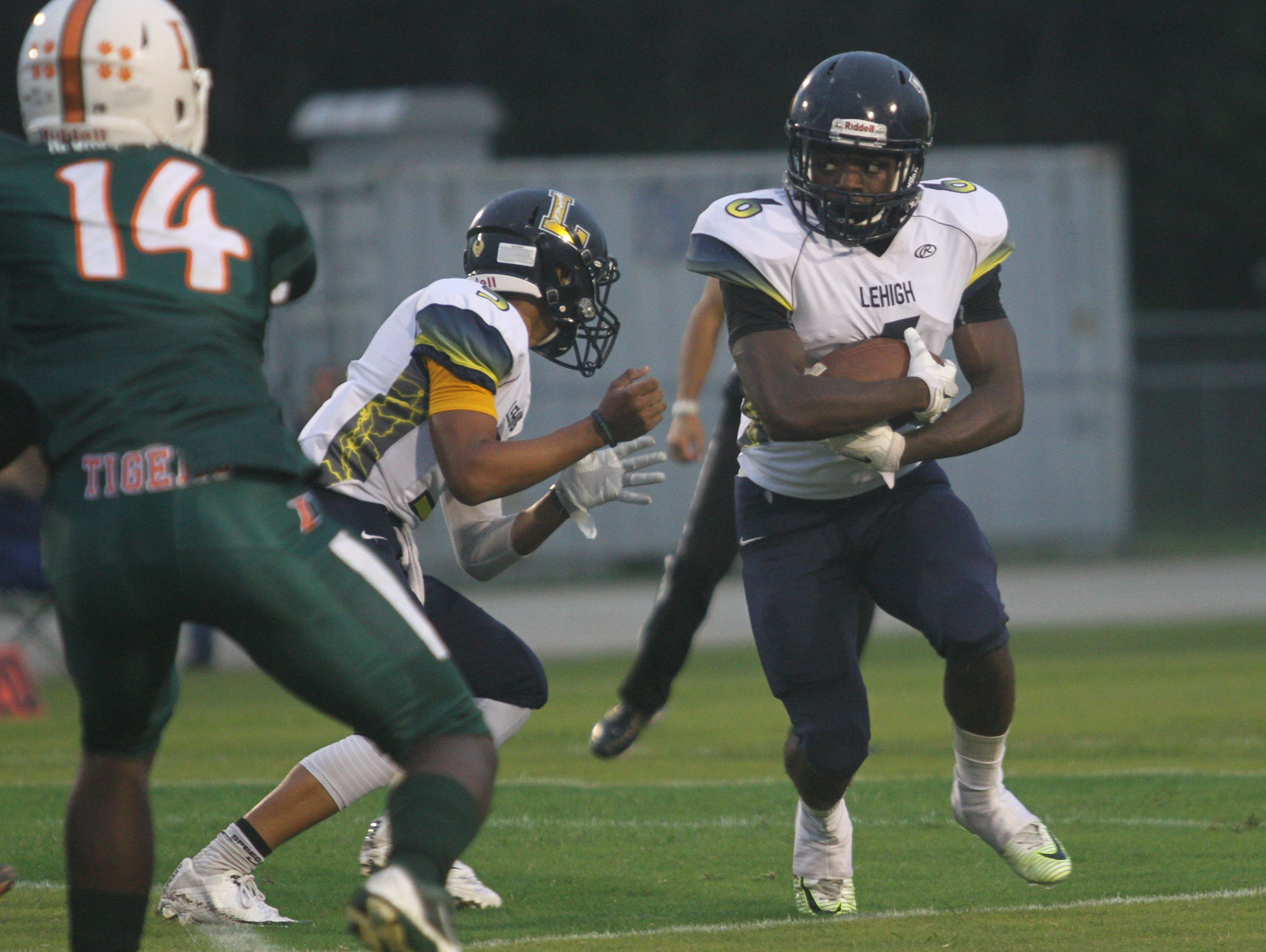 Lehigh running back Jalane Nelson carries the ball during the Lightning's 28-0 loss to Dunbar last week. Lehigh travels to South Fort Myers on Friday for The News-Press' Game of the Week.