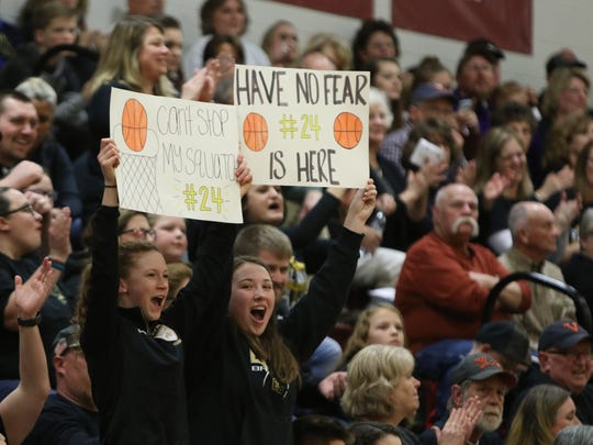 Buffalo Gap freshmen Samantha Huffer (left) and Natalie Robertson (right) cheer on their girls' basketball team at the Virginia High School Leage Class Quarterfinal game in Stuarts Draft on Friday, March 2, 2018.
