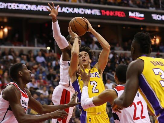 Washington Wizards guard John Wall (2) blocks the shot