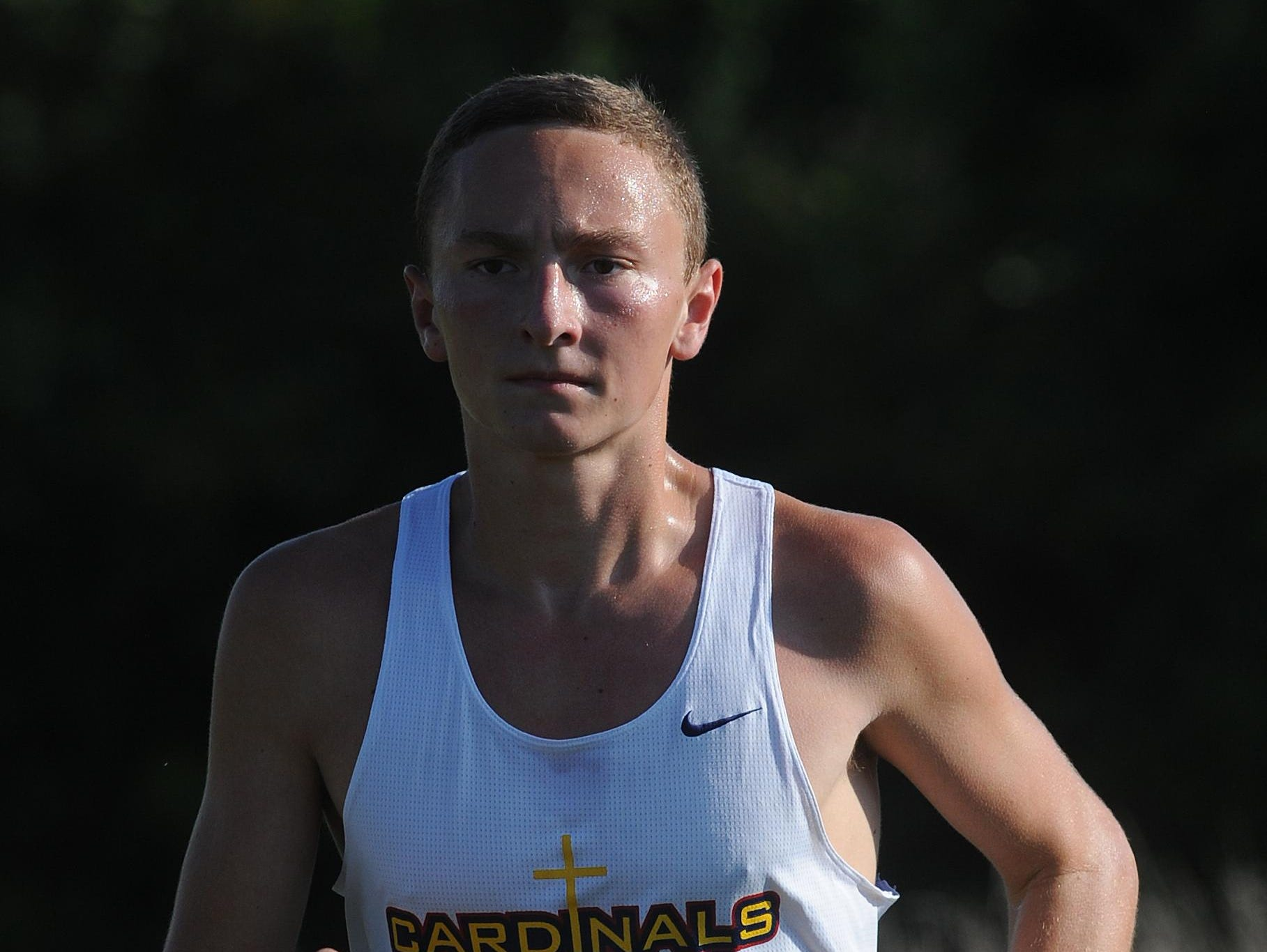 Seton's Jacob Stamm leads the Wayne County Cross Country race at Indiana University East during the 2013 cross country season.