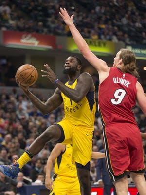 Lance Stephenson puts up two points as he is defended by Kelly Olynyk of the Miami Heat at Indiana Pacers, Bankers Life Fieldhouse, Indianapolis, Sunday, March 25, 2018.