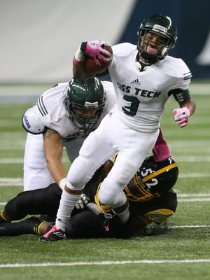 Detroit Cass Tech's Sean Hodges is tackled by Detroit King's Leon Page on Oct. 24, 2014, at Ford Field in Detroit.