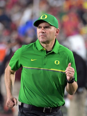 Nov 5, 2016; Los Angeles, CA, USA; Oregon Ducks head coach Mark Helfrich enters the field before a NCAA football game against the Southern California Trojans at Los Angeles Memorial Coliseum. Mandatory Credit: Kirby Lee-USA TODAY Sports