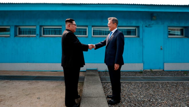 North Korea's Kim Jong Un , left, and South Korea's Moon Jae-in meet in late April.