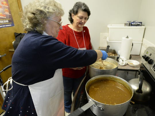 Diane Lopez, left, and Kathy Knapp, make gravy as they prepare for Thanksgiving dinner at the Salvation Army in Fort Collins Wednesday Nov. 27, 2013.