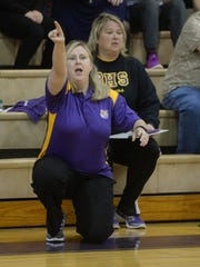 Benton head coach Mary Ward  calls out to her team.