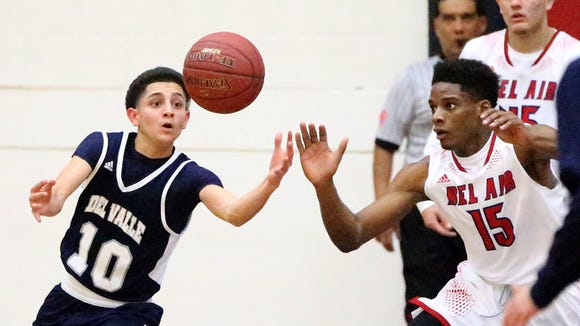Del Valle's Jon Bloberg, 10, goes after a loose ball