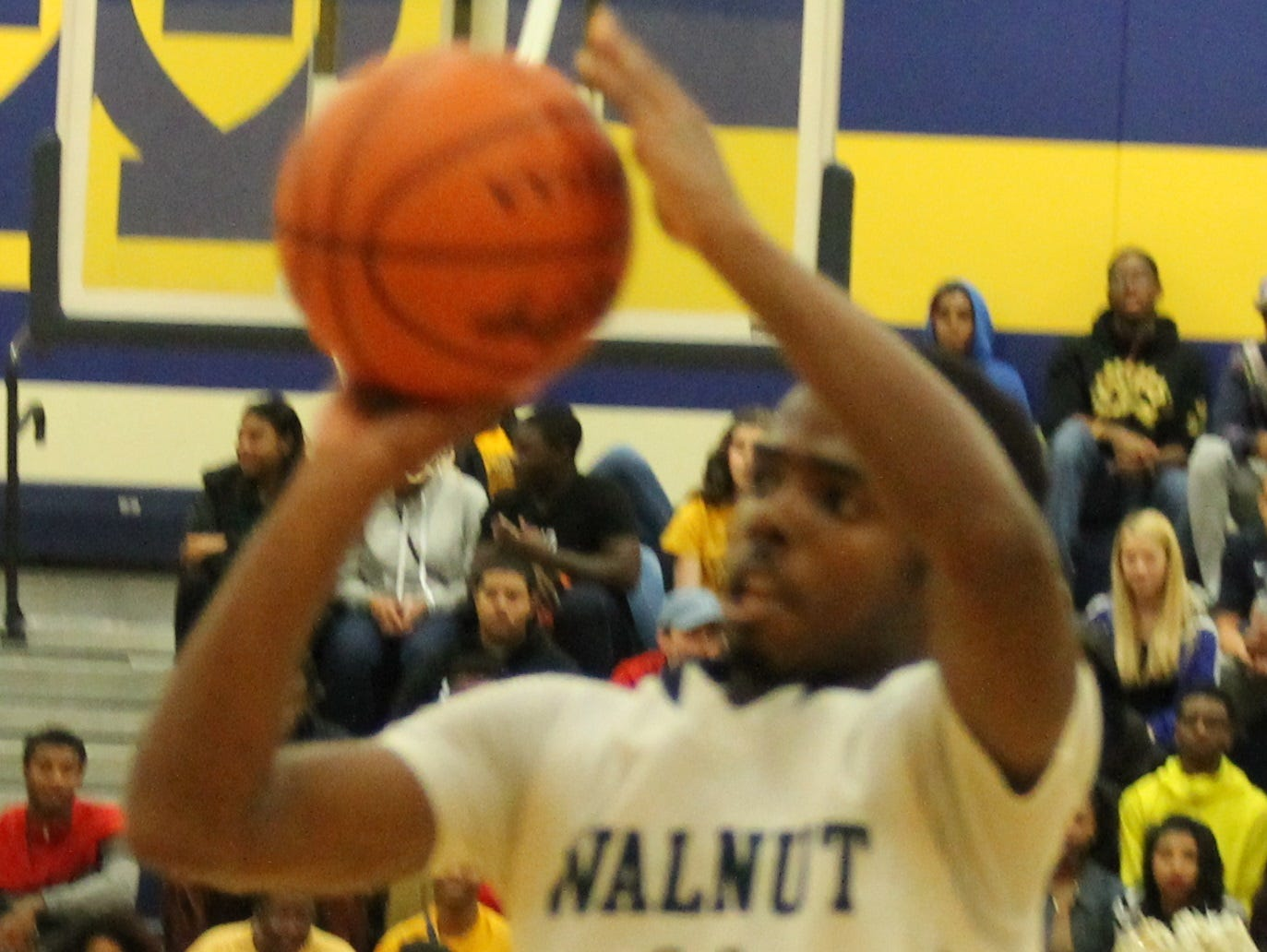 Walnut Hills' Malcolm Moffett shoots a triple to regain the lead for the Eagles.