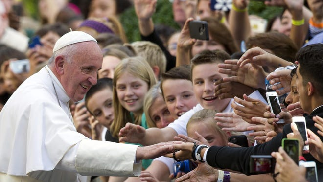 """The book """"Dear Pope Francis,"""" features questions posed for the pope from 30 children from around the globe."""