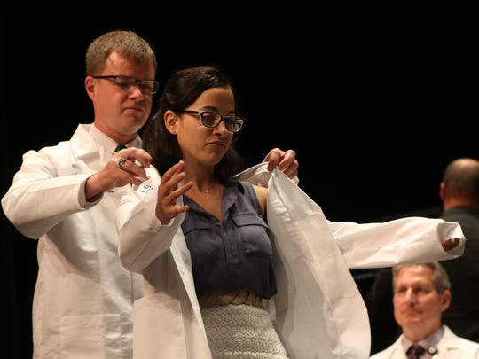 Stephanie Strohbeen is coated during the Medical College of Wisconsin Central Wisconsin White Coat Ceremony at UW Marathon County, in Wausau, Wisconsin, July 7, 2016.