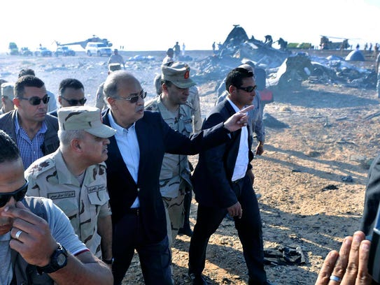 The Egyptian Prime Minister, Sherif Ismail gestures