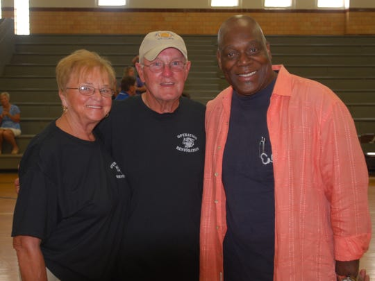 """Cold Case"" actor Thom Barry, right, got back together with his old Williamsburg High School football coach, Ken Osborne, center, and his wife, Sidney Osborne, at the June in Olde Wiliamsburgh festival June 6"