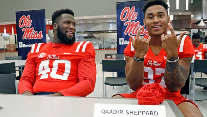 Defensive tackle Josiah Coatney (40) and Qaadir Sheppard (97) have vaulted themselves into Ole Miss' first-team defense during training camp.