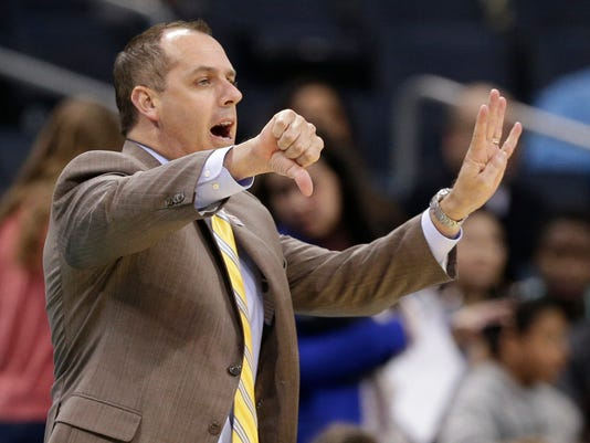 Orlando Magic head coach Frank Vogel directs his team against the Charlotte Hornets in the first half of an NBA basketball game in Charlotte, N.C., Friday, March 10, 2017. (AP Photo/Chuck Burton)