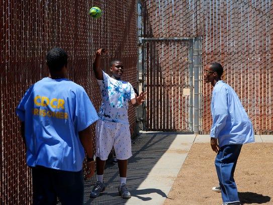 Cameron Francisco, 13, throws a football while playing