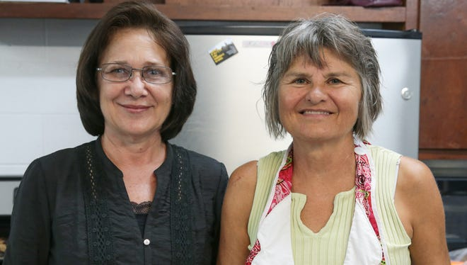 Tammy Aguon (left) and Betty Jo Wresch pose for a photo during SDA's Healthy Cooking Class on June 28, 2015.