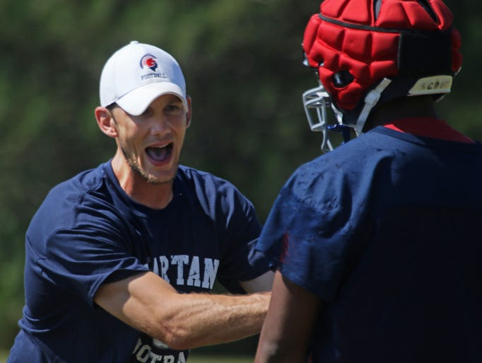 New Brookfield East football coach Ben Farley demonstrates