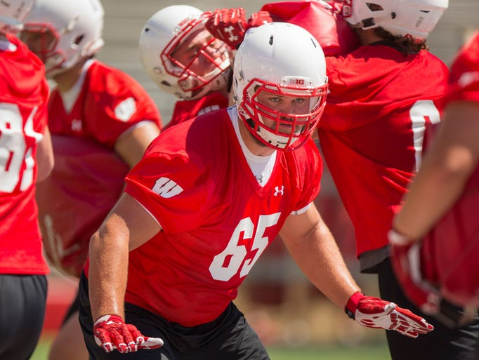 Wisconsin's Ryan Ramczyk runs a drill.