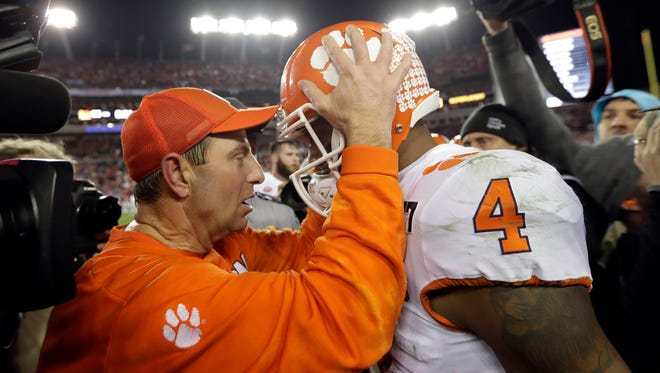 Clemson head coach Dabo Swinney talks to Deshaun Watson during the second half of the NCAA college football playoff championship game against Alabama on Tuesday in Tampa, Fla.