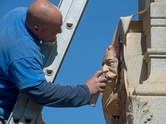 Bill Lloyd with Gulf Coast Wilbert Inc. of Crestview works on renovations to the Chipley Monument in Plaza Ferdinand in downtown Pensacola in February 2015.