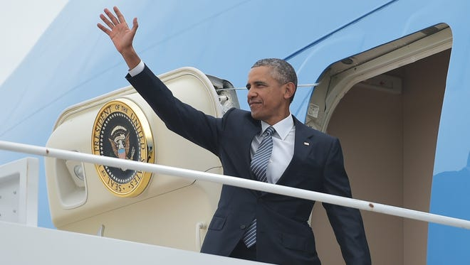 President Obama boards Air Force One on Monday at Andrews Air Force Base in Maryland as he heads to Alaska. While there, Obama will tape a special episode of NBC's 'Running Wild with Bear Grylls,' the network announced Monday.