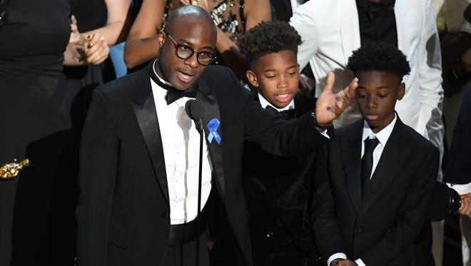 Writer/director Barry Jenkins, actors Jaden Piner and Alex R. Hibbert accept Best Picture for 'Moonlight' onstage during the 89th Annual Academy Award.