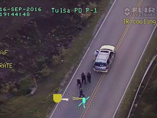 In this image made from a Friday, Sept. 16, 2016 police video, Terence Crutcher, top, is pursued by police officers as he walk to an SUV in Tulsa, Okla. Crutcher was taken to the hospital where he was pronounced dead after he was shot by the officer around 8 p.m., Friday, police said. Crutcher had no weapon on him or in his SUV, Tulsa Police Chief Chuck Jordan said Monday, Sept. 19, 2016.