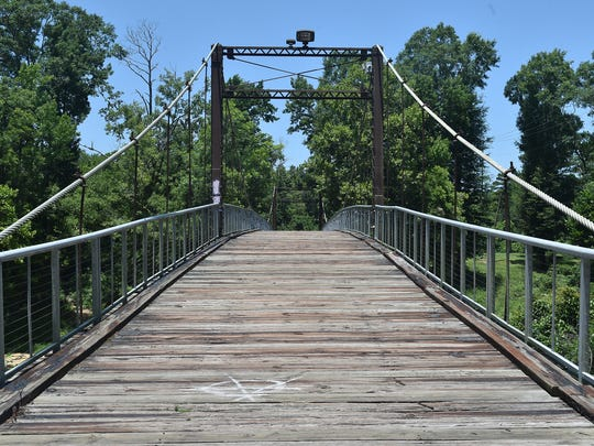 Built in 1905, the Swinging Bridge in Byram is closed to vehicle traffic but has become a place where couples leave locks as symbols of their love.