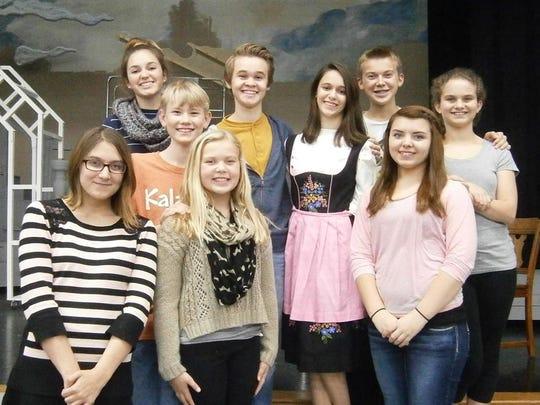 """The Sound of Music"" hits the Ashwaubenon High School stage starring, from left, Megan Nemchek, Anna Larsen, Matthew Hawkins, Karleigh Conradt, Jeff Larson, Beth LeGreve, Bailey Conradt, Kaia Matzki, and Laura Bottei."