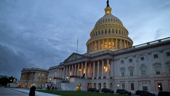 The U.S. Capitol building at dusk in Washington.