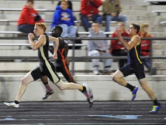 Red Lion's Ryan Knisley leads Central York's Angelo Koimene and Littlestown's Brandon Study in the 200 meter race at last year's YAIAA track and field meet. Knisley won the race. (Daily Record/Sunday News -- file)