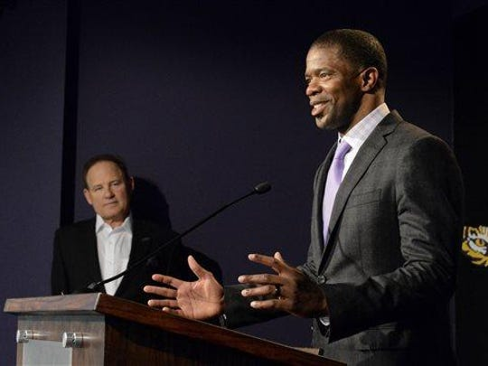 LSU head coach Les Miles, left, listens as newly appointed LSU wide receivers coach Dameyune Craig speaks during a press conference